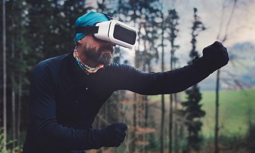 Man exercising while wearing VR headset